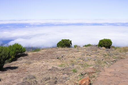 Panoramic view of a desertic place with shrubs above clouds (Madeira, Portugal, Europe) Stock fotó