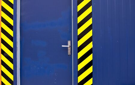 Blue door with black and yellow stripes: access denied, work in progress (Prague, Czech Republic, Europe)