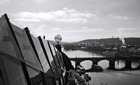 Panoramic view from the rooftop of the Dancing House with a bridge over the Vltava river in the background (Prague, Czech Republic, Europe)
