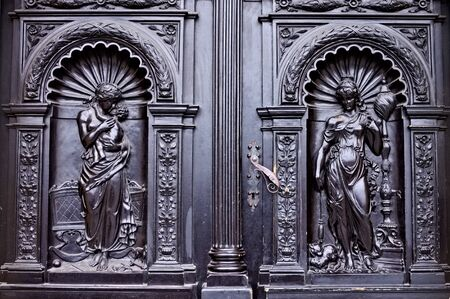 Iron handling of a decorated black door with bas-reliefs (Prague, Czech Republic, Europe) 報道画像