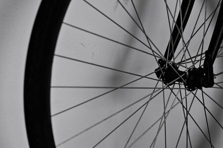 Bicycle wheel against a dirty wall in the garage (Pesaro, Italy, Europe) Banque d'images