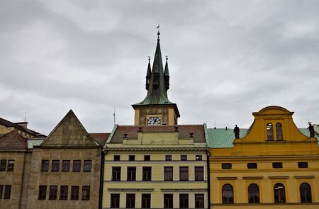 Old bohemian buildings with decorated roofs and spires (Prague, Czech Republic, Europe)