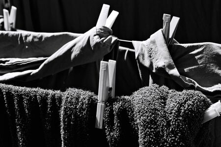 Towels and clothes hanging on a drying rack with clothespins (Pesaro, Italy, Europe) Archivio Fotografico