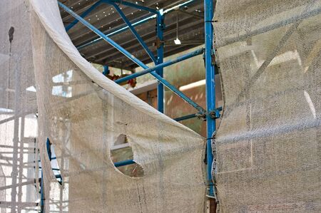 A broken scaffolding protection net in a building site (Pesaro, Marche, Italy)