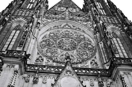 Prague, Czech Republic - December 28, 2019: Exterior details of St. Vitus Cathedral, a gothic religious building with towers, spires and mosaic decorations