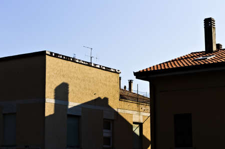 The shadow of a chimney and a roof on a building wall (Pesaro, Italy, Europe)