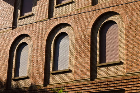 Brick facade with round arches of an old building (Pesaro, Italy, Europe) 版權商用圖片