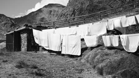 Clothes hanging in the garden of a mountain hut in the Alps (Trentino, Italy, Europe)