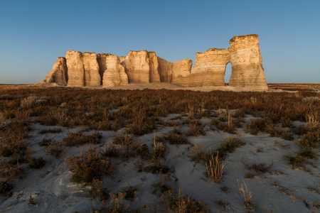 great plains: A horizontal landscape photography image of Monument Rocks in Kansas before sunset.  They are also known as Chalk Pyramids.