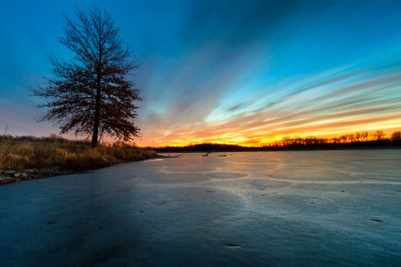 frozen lake: A frozen lake in Missouri during the winter at sunrise Stock Photo