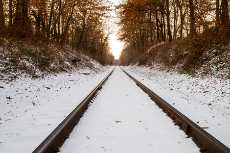 Railroad tracks covered in snow. photo