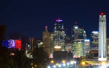 A view of Kansas City, Missouri skyline at night from an elevated view point.  It includes the Liberty Memorial landmark. Stock Photo
