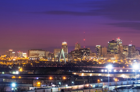 Cityscape view of the Kansas City, Missouri skyline with the Kit Bond Bridge as part of the scene