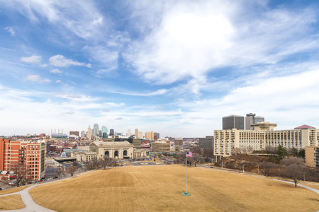 Wide angle view of Kansas City, Missouri during the daytime with all trademarks removed.