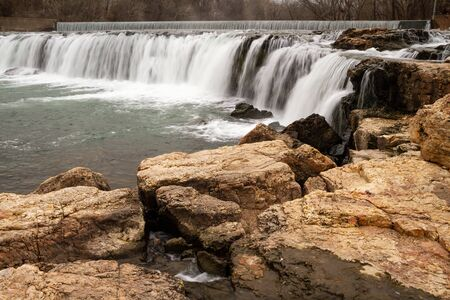 Wide view of Grand Falls in Joplin, Missouri.  It is located in the Southwest part of the state.  It is a landmark in the area.