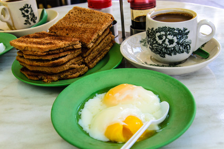 breackfast: breackfast singapore  people enjoy at ya kun kaya toast in singapore Stock Photo
