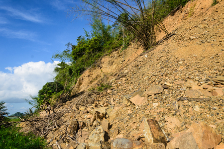trespass: mountain soil dig smuggle and slide in thailand Stock Photo