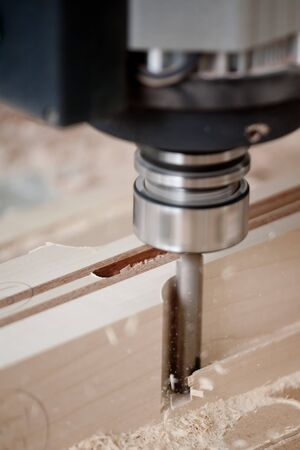 cutting wood with a CNC milling machines Stock Photo - 4243358