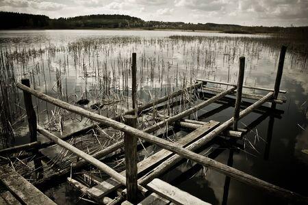 rundown: Rundown pier in reed, horizontal