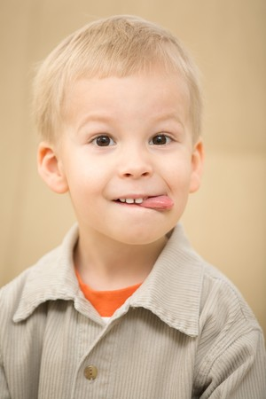corduroy: Boy sticking out tongue with a funny face