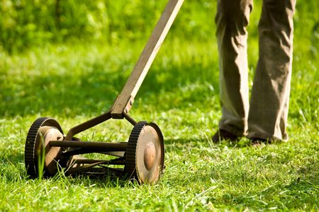 Old, cast iron lawn mower. Archivio Fotografico