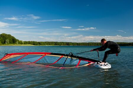 wideangle: Windsurfing lessons on the lake, pick-up sail Stock Photo