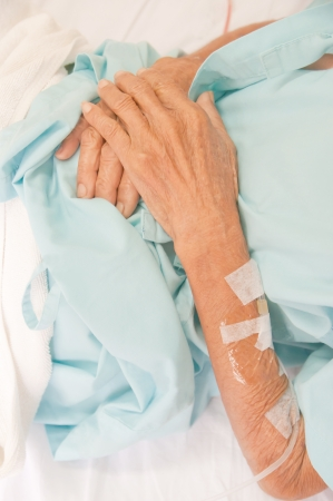 Arm of a female patient in the hospital with an IV drip