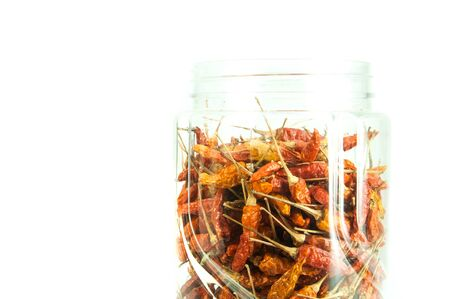 Dried red peppers on white background  photo