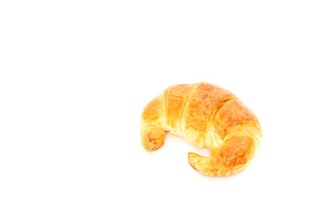 Fresh delicious croissant isolated over white background