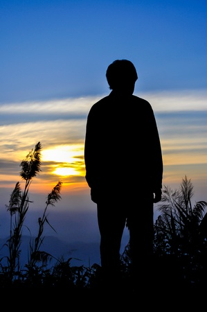 Silhouette of man on the sunset Stock Photo - 14354748