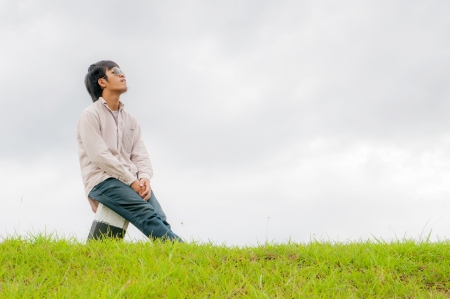 happy young man rest on the grass field Stock Photo - 14392855