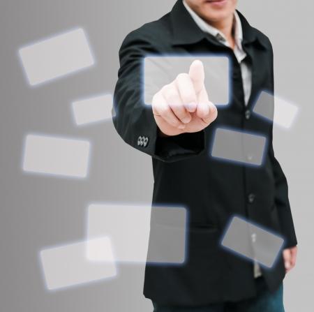 Man hand push on technology virtual touch screen interface Stock Photo - 14462376
