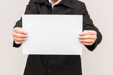 holding blank sign: Business man holding a4 paper