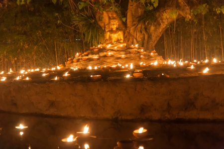 thai believe: pray to buddha statue and candle in Chiangmai Thailand