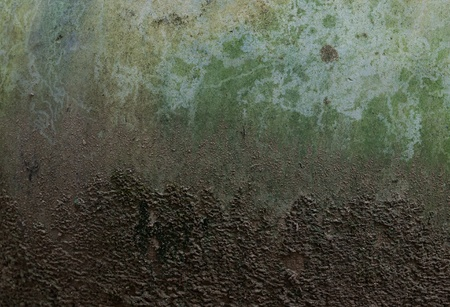 patina: Grungy concrete wall and soil ground