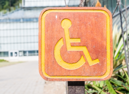 Handicapped symbol on the park photo