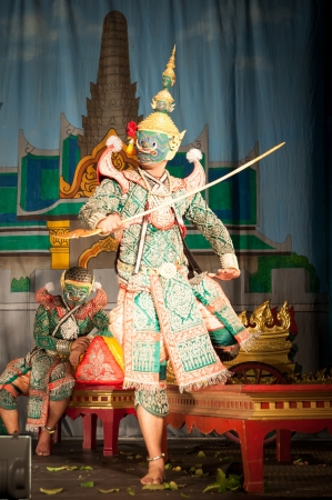 Lamphun, THAILAND - March 19  Thai Traditional Dress  actors performs Thai ancient dancing Art of Khon-Thai classical masked ballet in Thailand, March 19, 2013 in Lamphun, Thailand