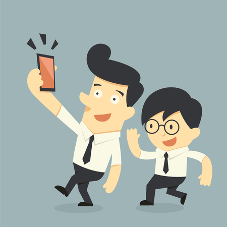 using smart phone: Businessman taking selfie