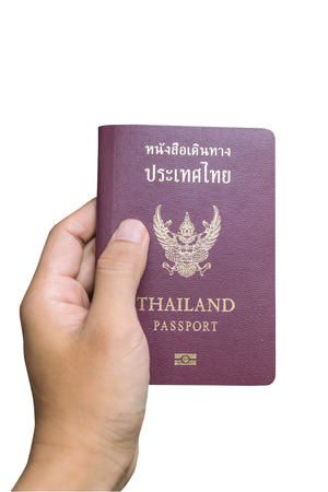 Hand holding passport isolated Standard-Bild