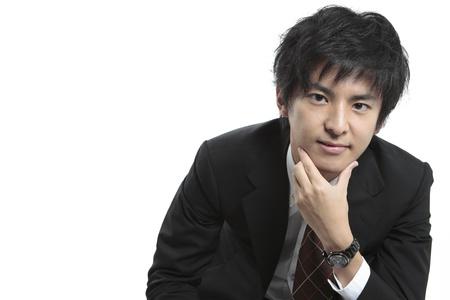asian business man: Business man contemplating
