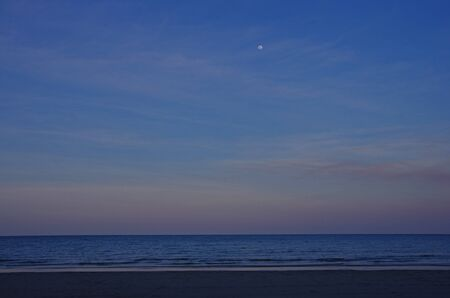 tribulation: the sea and the moon in the evening Stock Photo