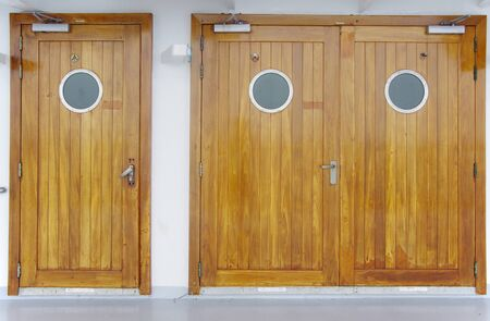 wooden doors with a cicle window photo
