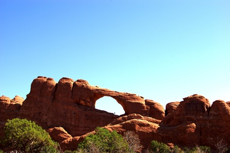 Skyline Arch and a person in Arches National Park