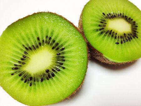 Kiwi fruit cut in halves Stock Photo