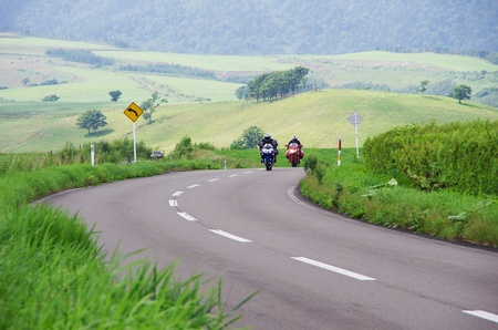 two motorcycles coming to a corner