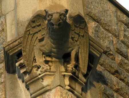 Winged gargoyle on vintage church.