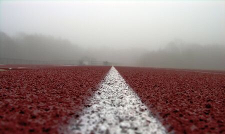 Foggy track and a white line on red.