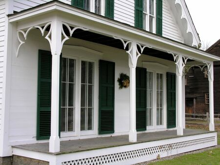 Front porch of old Victorian style house.