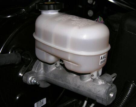 Brake Master Cylinder and Reservoir on a motor vehicle.