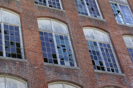 property development: Damaged and vandalized factory building. Stock Photo